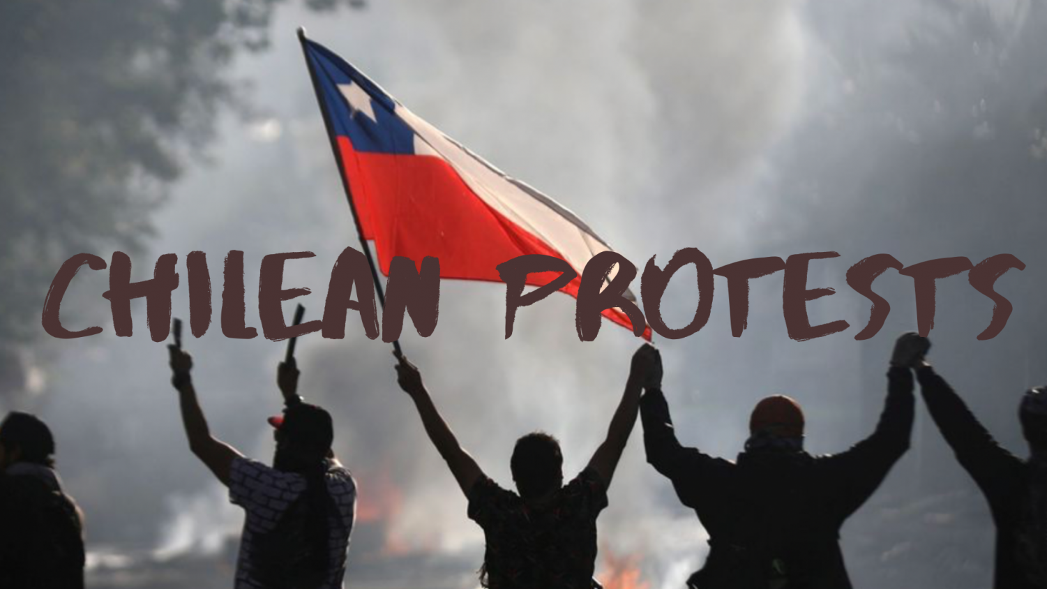 A group of Chilean Protesters in front of a fire