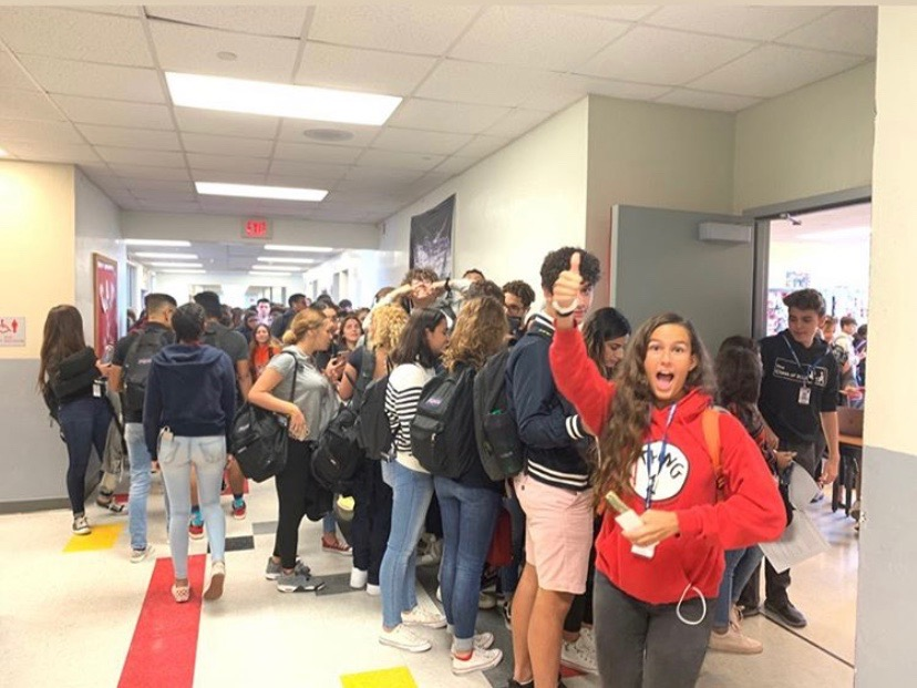 Students excitedly purchasing their homecoming tickets.