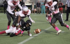 The Cavalier Football defense scrambles for the loose football during a game Mater Academy Charter school.