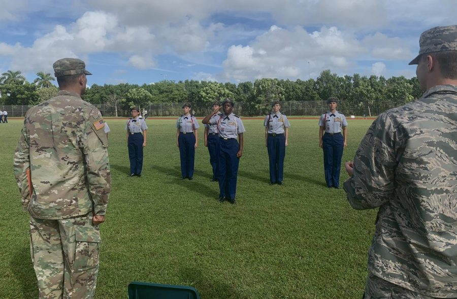 The JROTC stands at attention during their drills, waiting for instructions.