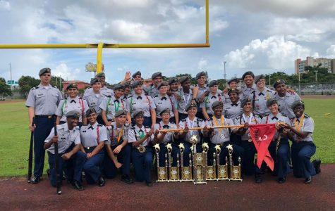 Junior Reserve Officers' Training Corps pose with the trophies they won from their drill competition.