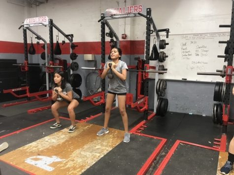 The Lady Cavaliers condition in the Cavalier weight room, performing strength training in preparation for the upcoming winter soccer season.