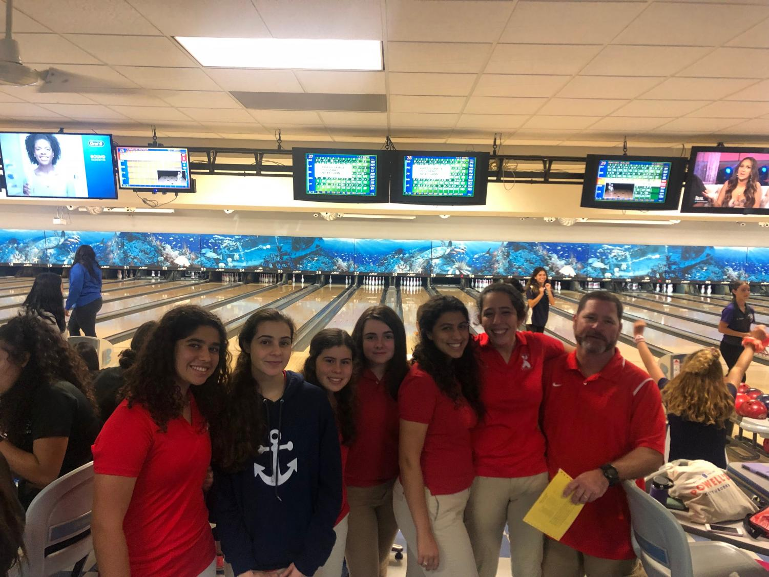 The Coral Gables Lady Cavalier Bowling team poses for a team picture with coach Campagna.