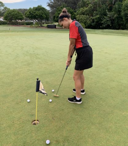 Lady Cavalier golfer Sofia Alfonso practicing her putting before competing in the regional championship competition