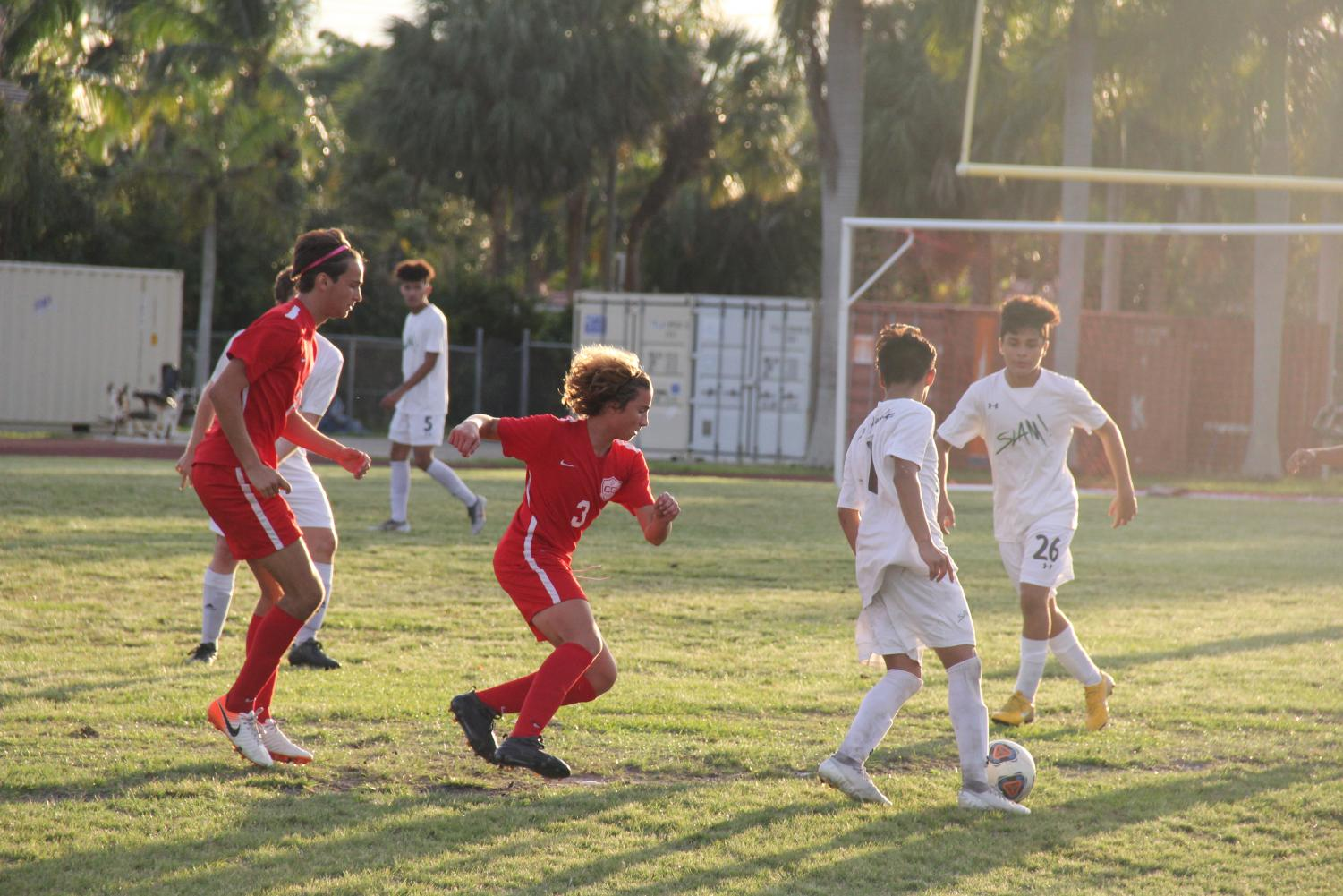 The Coral Gables Cavaliers fighting to regain possession of the soccer ball from SLAM, where the Cavaliers showed their offensive prowess with a 5-1 victory.