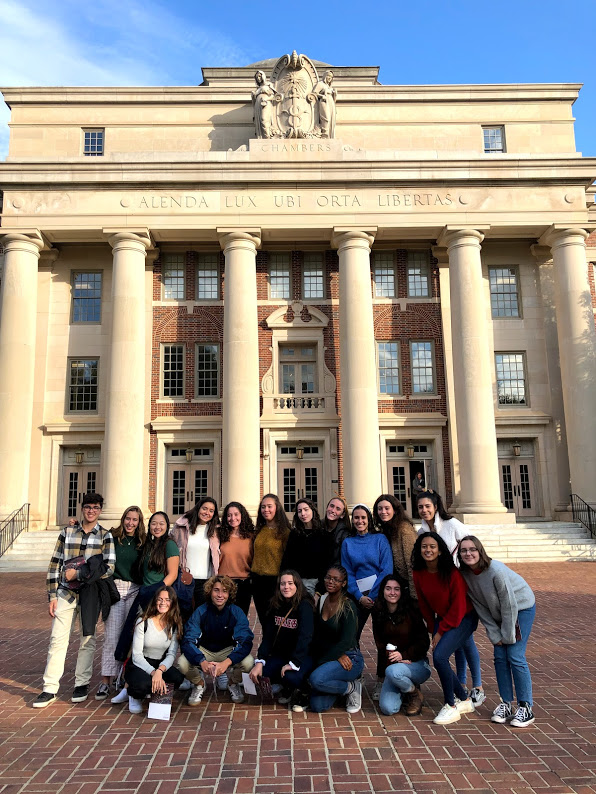 The+2019+college+tour+group+poses+for+a+photo+outside+of+a+library+at+Davidson+College+in+North+Carolina.+