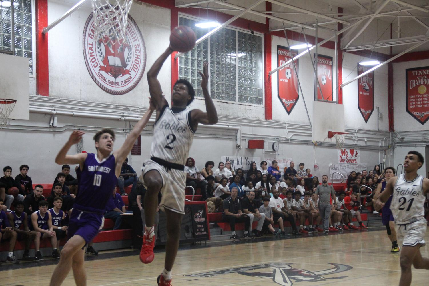 Cavalier Jimel Lane rises up for an emphatic dunk against the Southwest Eagles as the Coral Gables Cavaliers defeat the Eagles 83-63 during their last regular season home game on Jan. 29.