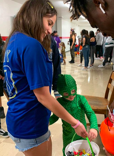 Child Care student Trick or Treating in the school´s halls.