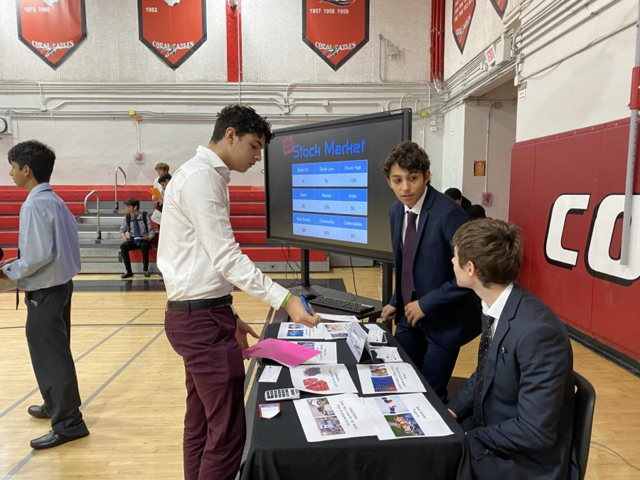 A student examines his options for investing in the mock stock market during the 2019 Mad City Money event.