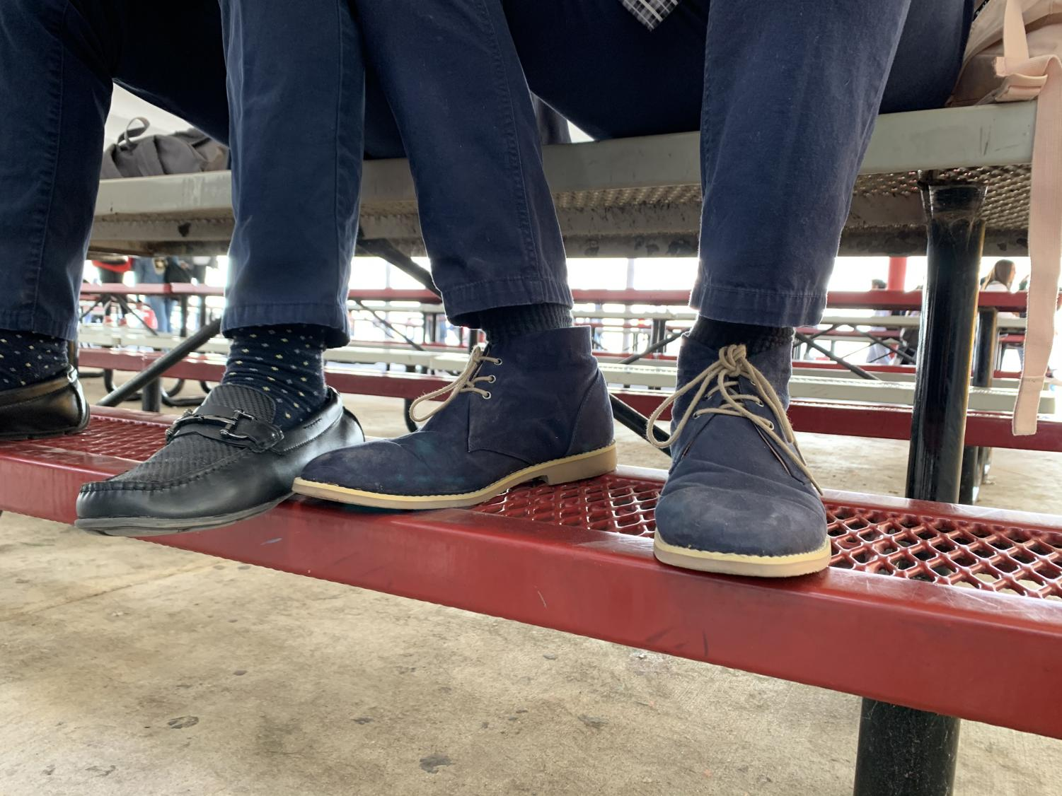 Cavaliers show off their fresh kicks in the dining pavilion, accessorizing the school uniform.