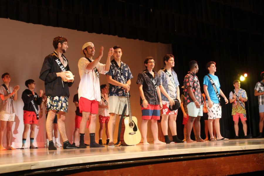 The Top Ten contestants stand in front of the rest of the group, waiting to compete in the second half of the show's events.