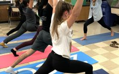 The Gables yoga instructor demonstrates how to properly do the warrior one pose.