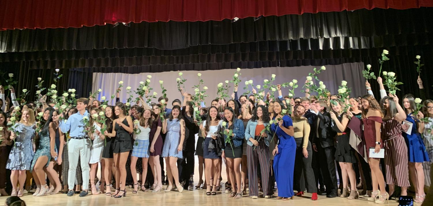 At the end of the ceremony, the junior class gathered on stage to show off their pins and roses.