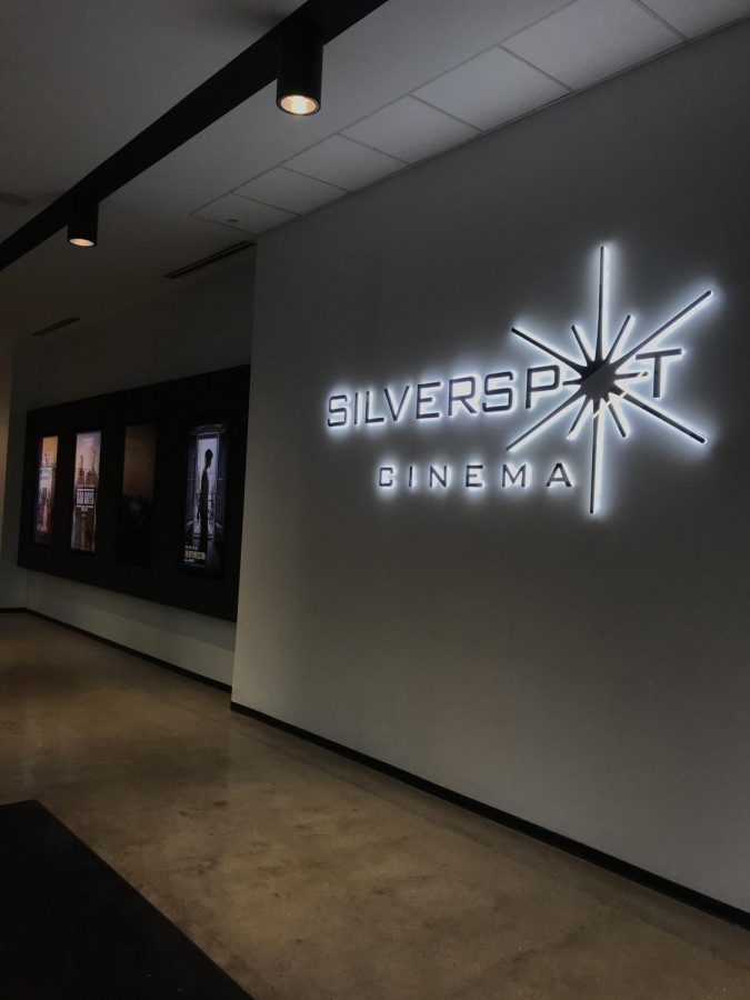 Silverspot theater displays their most recent showings on brightly lit posters.