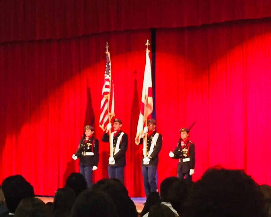 The ceremony began with The Pledge of Allegiance and National Anthem, while JROTC students presented the American Flag to the audience.
