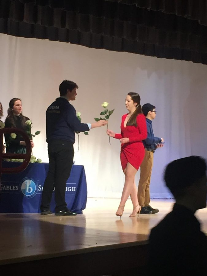 After hearing their names announced, the juniors walked across the stage to greet Mr. Costa and Ms. Van Wyk and receive a white rose from the senior volunteers.