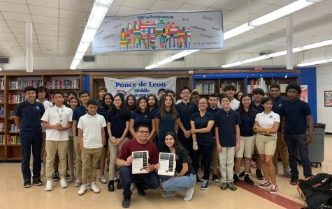 Michaela Torres and Daniel Fernandez in the media center at Ponce De Leon Middle School, with the group of kids they presented to.