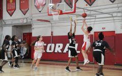 Senior Isabella Pinera swiftly shot a jump shot against the Miami Carol City Senior High School Chiefs.
