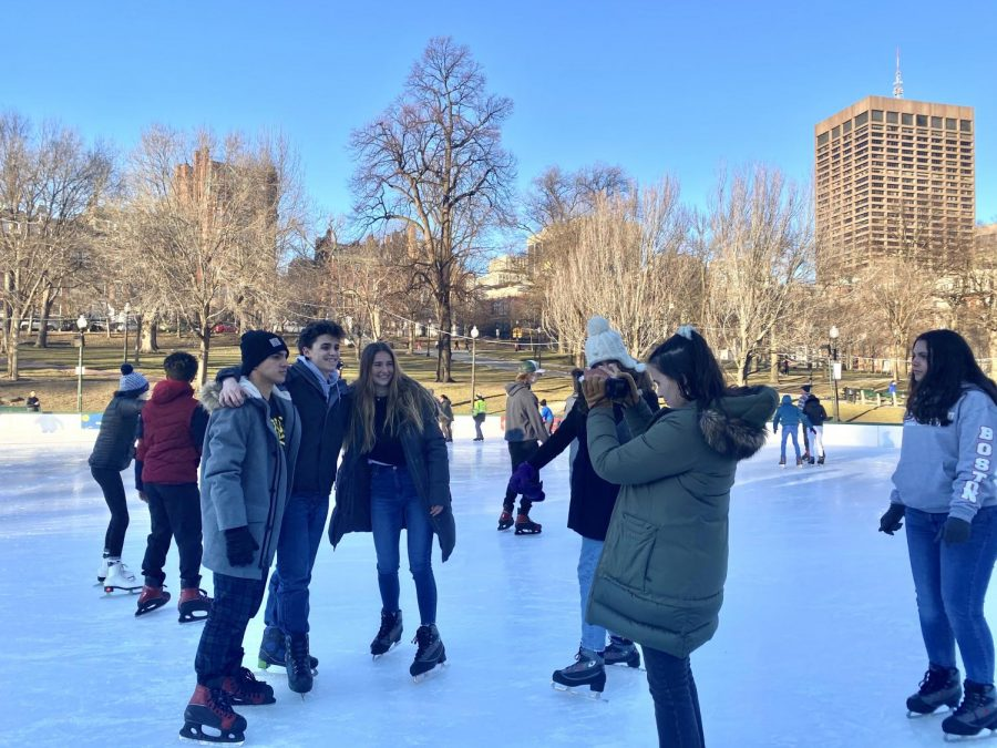 Junior Alexandra Torres photographs several other students while ice skating.
