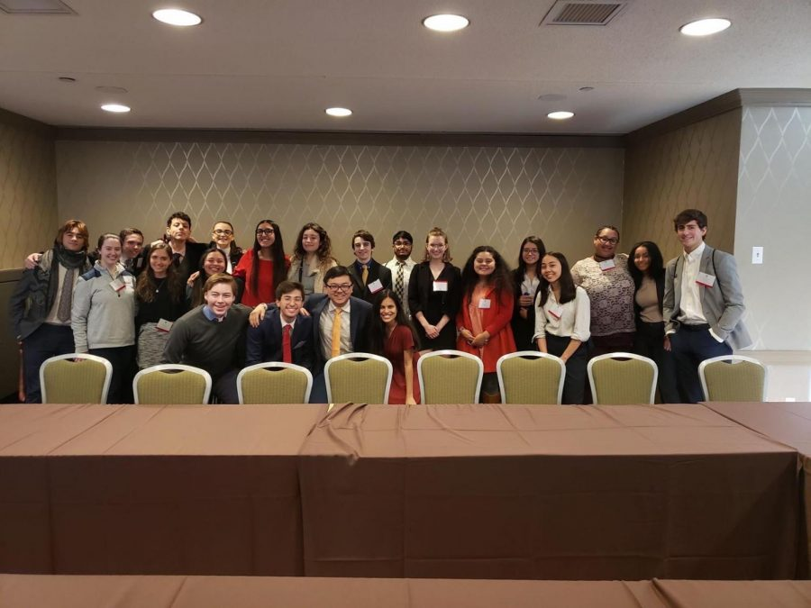 Juniors Sofia Rebull and Aya Hamza join their Committee on Natural Resources, Energy and Commerce for a group photo.