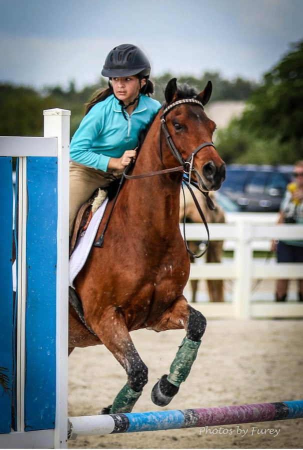 Victoria Mavarez and her horse, Indie, during a competition in 2016.