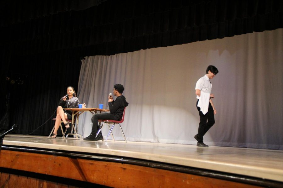 Students performed a short skit about a couple in a restaurant.