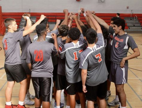 On Mar. 2, in the Coral Gables High school gym, the Cavalier Volleyball team banded together to devise their plan of attack against the International Studies Charter High school.
