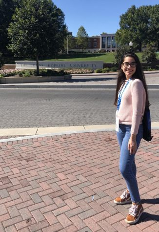 Senior Lia Sanchez standing in front of her dream college, to which she has recently committed to.