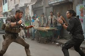 Featured above a very aggressive fight scene between Tyler Rake (Chris Hemsworth) and