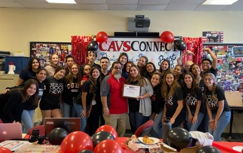 Principal Costa stands with the CavsConnect staff after awarding them a Sunshine Standout plaque.