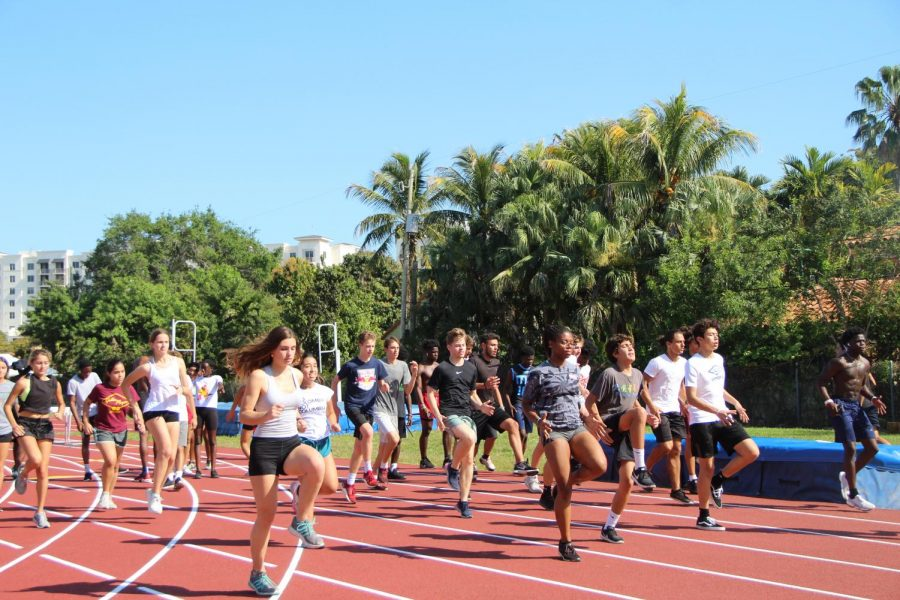 The 2019-2020 Gables track team warms up after school on the track for practice before coronavirus forced them to end their season early.