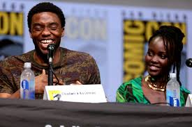 Boseman is pictured smiling with one of his co-stars, Lupita Nyong