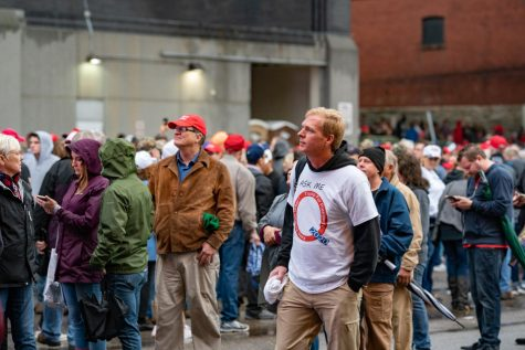 QAnon believer found in Trump rally crowd.