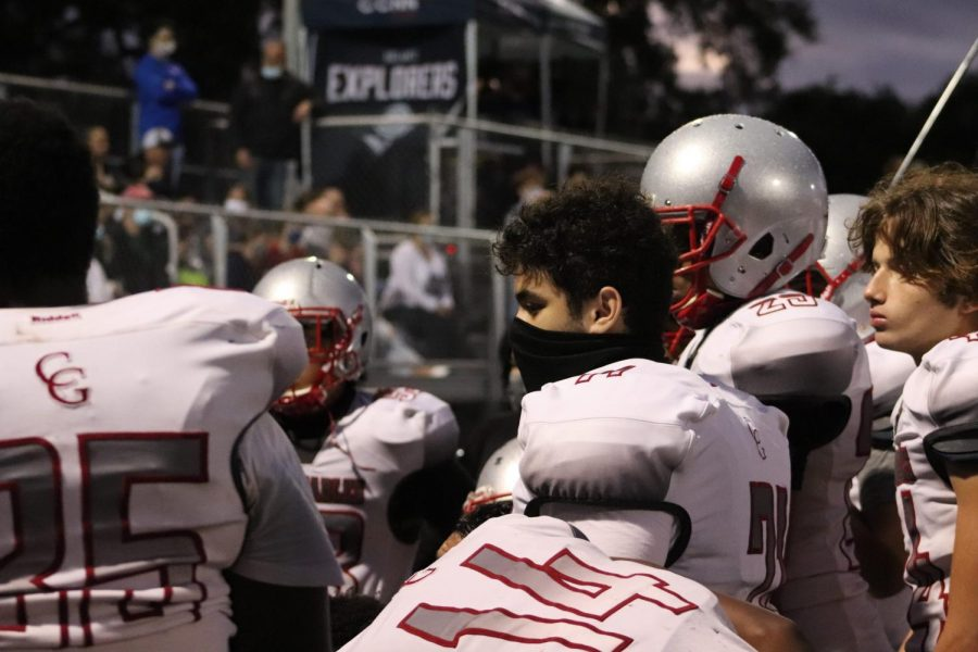 Junior Defensive Linemen David Kuper huddles with his teammates to discuss their next move.