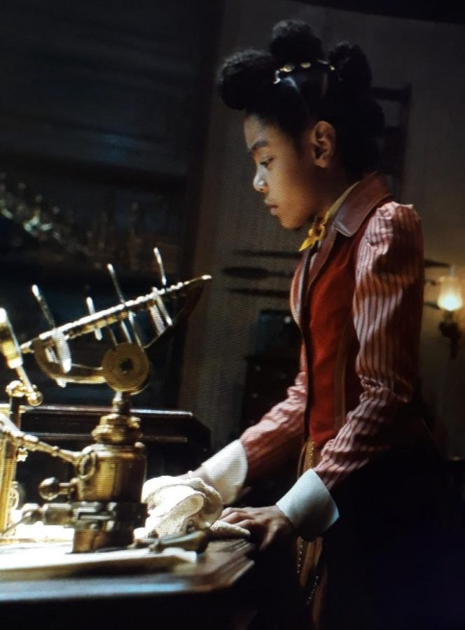 Journey tries to help her grandfather Jeronicus unlock the magic within his newest toy in the New Netflix movie, Jingle Jangle