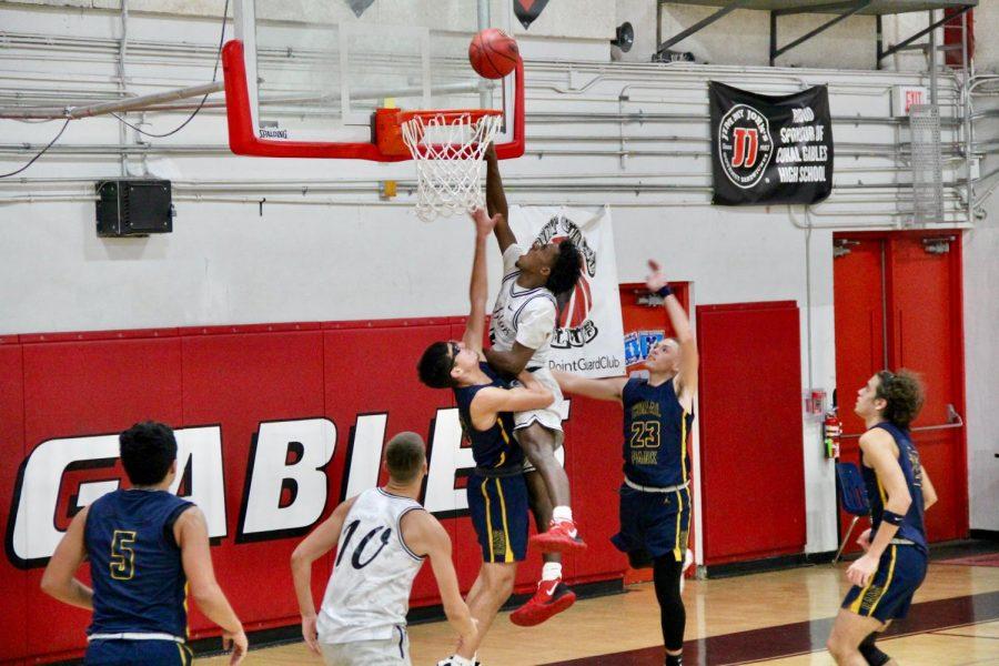 Varsity player, Jonathan Similien attacking the basket.