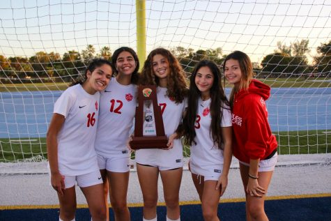Varsity Juniors pictured with the District Championship trophy.