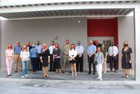 Principal Ullivarri stands alongside members of FOGH and Miami-Dade School Board member Mari Tere Rojas in front of what will soon become the outdoor pavilion area of the new building.