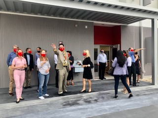 Principal Ullivarri stands alongside members of FOGH and Miami-Dade School Board member Mari Tere Rojas as they admire what will soon become the outdoor pavilion area of the new building.