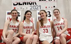 On Jan. 29 the underclassmen of the Lady Cavaliers basketball team said farewell to seniors, Madeline Cohen (furthest left), Isabelle Barbery, Catherine Pasternac and Mia Crabill (furthest right).