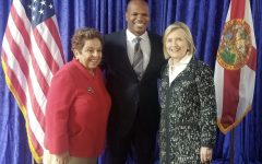 Marcus Dixon is seen here posing with former representative Donna Shalala (left), and former Secretary of State Hillary Clinton (right). (courtesy of Marcus Dixon)