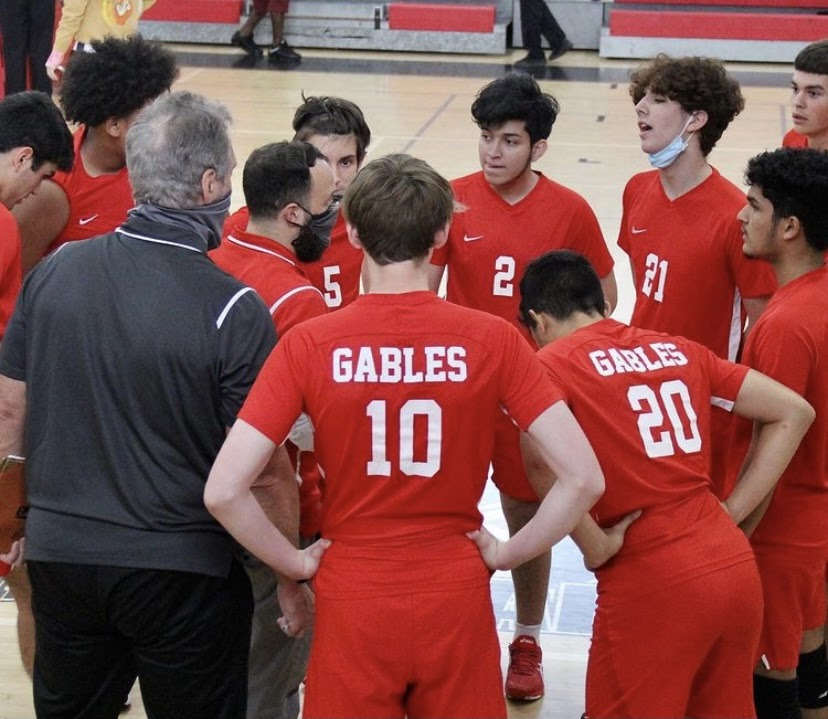 The Cavalier volleyball team in a team huddle in the midst of a game against Westland.