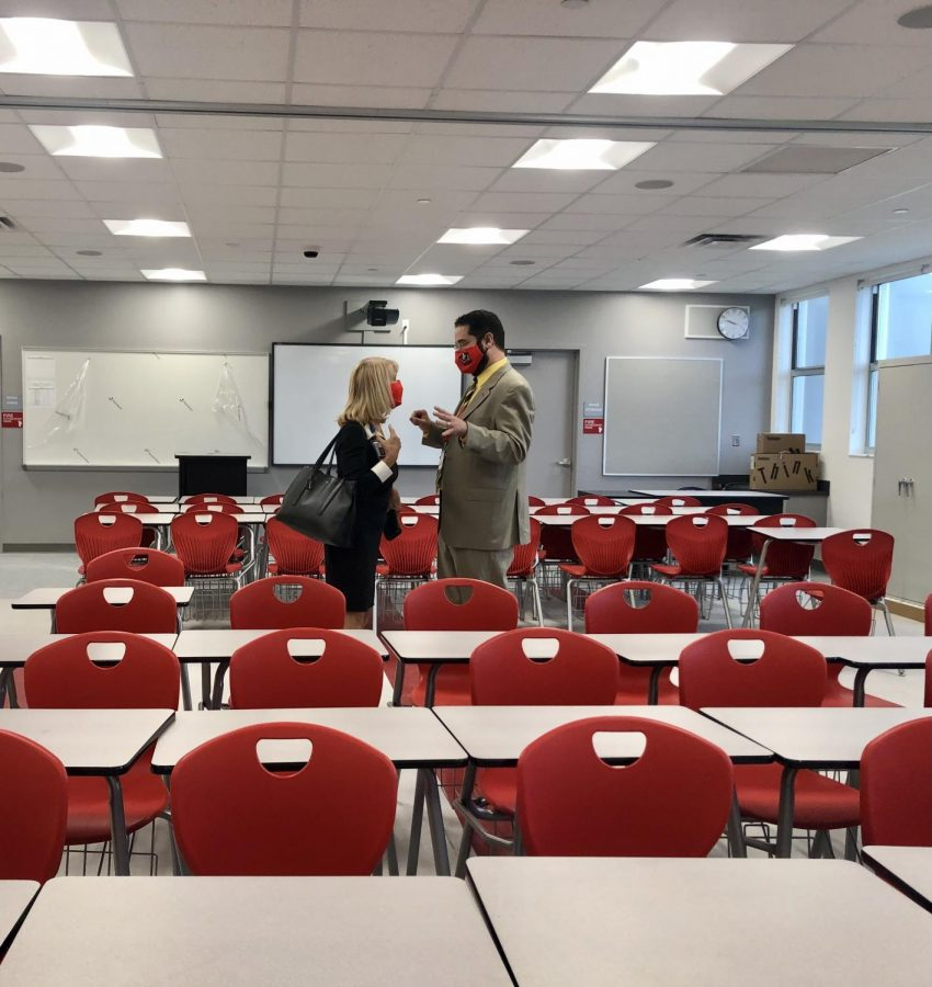 Mari Tere Rojas and Mr.Ullivarri converse in the middle of a brand new classroom on the second floor.