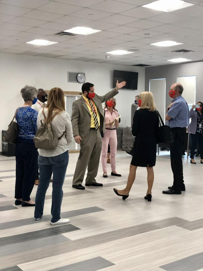 Mr.Ullivarri shows the brand new cafeteria to FOGH members and Mari Tere Rojas.