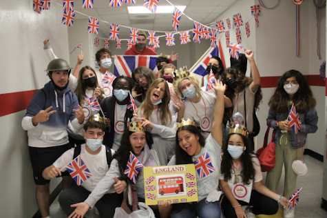 Students in the England group, alongside their student group leaders and teacher helpers, showing off their pride.
