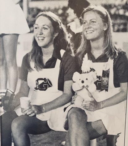 Wanting to make the most of her high school experience, Morris (right), joined numerous extracurriculars including cheerleading.