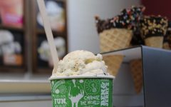 On the counter at the Coral Gables Ben & Jerry's scoop shop, sits a cup of Mint Chocolate Chunk ice cream