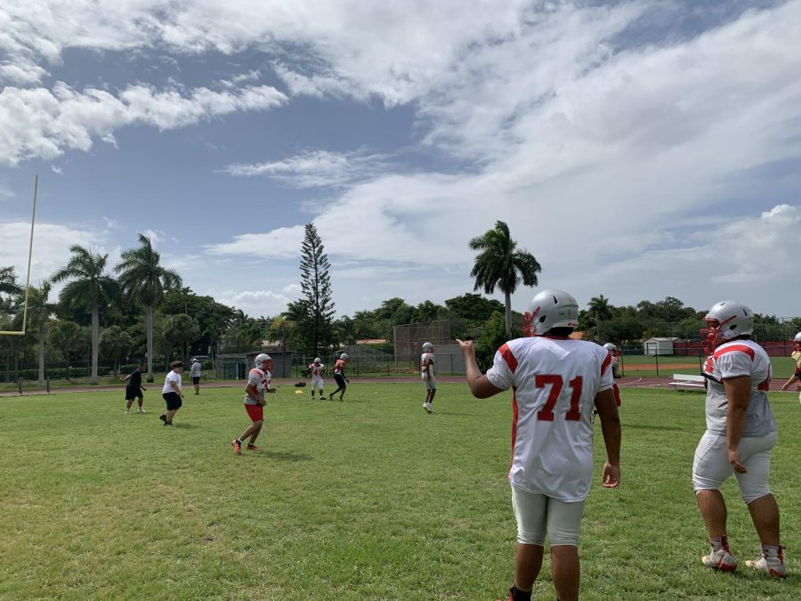 The Coral Gables Senior High football team running routine drills after school in preparation for their game on Aug. 27.