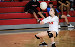 Georgia Rau, libero for the girls JV Volleyball team, getting in position to hit the ball.