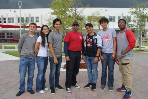 The Chess Club board members, Adrian Gonzalez, Maria Montelongo, Diego Gomez, Massimo Aguila, Ruben Cruz and Edghlys Lopez (left to right) pose alongside Mr. Sanchez for their first yearbook picture.